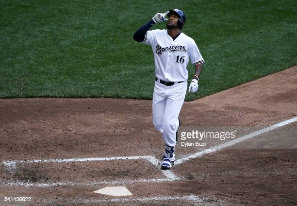 Domingo Santana of the Milwaukee Brewers rounds the bases after hitting a home run in the sixth inning against the St Louis Cardinals at Miller Park...