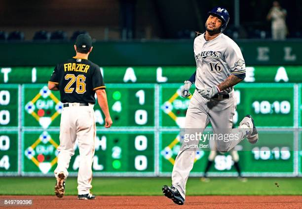 Domingo Santana of the Milwaukee Brewers rounds the bases after hitting a solo home run in the fourth inning during the game against the Pittsburgh...