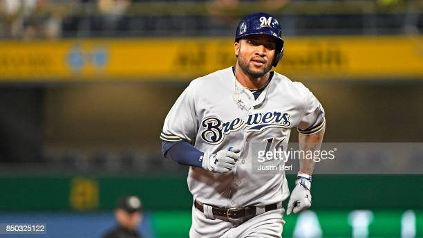 Domingo Santana of the Milwaukee Brewers rounds the bases after hitting a solo home run in the third inning during the game against the Pittsburgh...