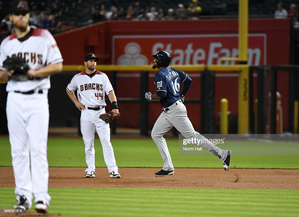 Domingo Santana #16 of the Milwaukee Brewers rounds the bases after hitting a solo home run as Paul Goldschmidt #44 of the Arizona Diamondbacks looks on during the first inning at Chase Field on May 16, 2018 in Phoenix, Arizona.