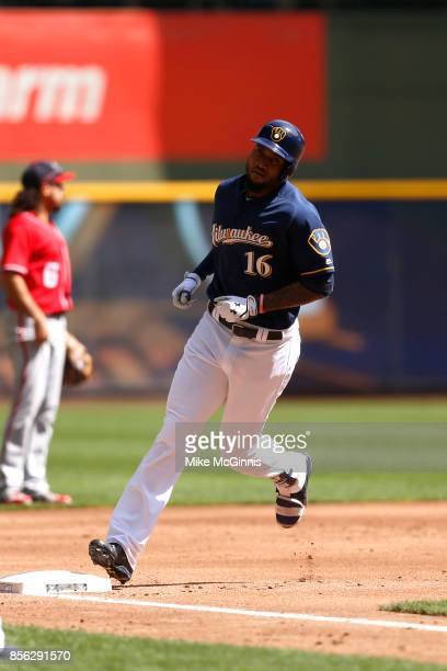 Domingo Santana of the Milwaukee Brewers runs the bases after hitting during the game against the Washington Nationals at Miller Park on September 03...