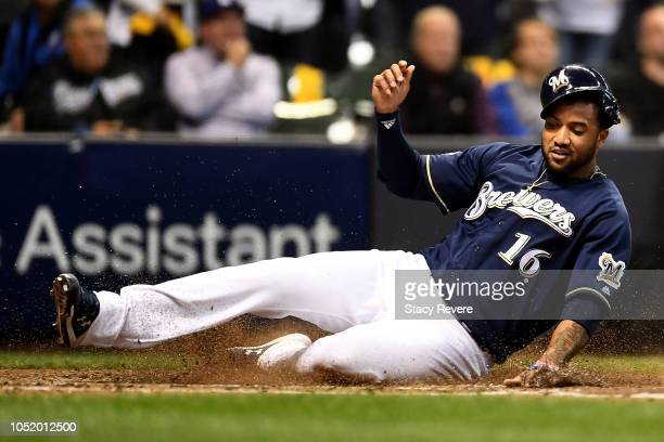 Domingo Santana of the Milwaukee Brewers scores a run off of a single hit by Ryan Braun against the Los Angeles Dodgers during the fourth inning in...