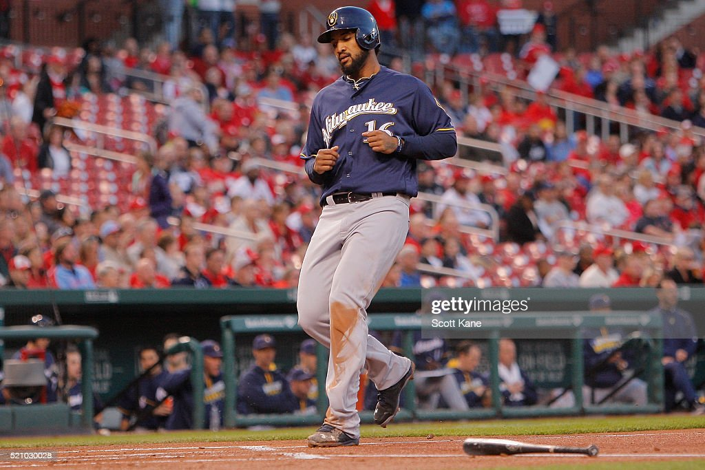 Domingo Santana #16 of the Milwaukee Brewers scores on a RBI single by Jonathan Lucroy #20 during the first inning of a baseball game against the St. Louis Cardinals at Busch Stadium on April 13, 2016 in St. Louis, Missouri.