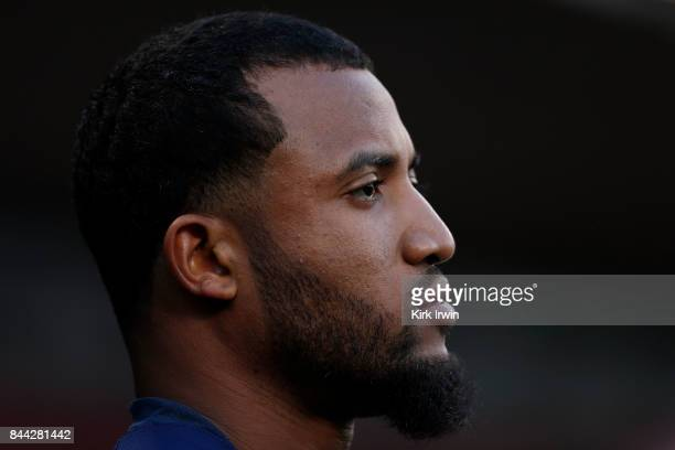 Domingo Santana of the Milwaukee Brewers sits in the dugout during the game against the Cincinnati Reds at Great American Ball Park on September 5...