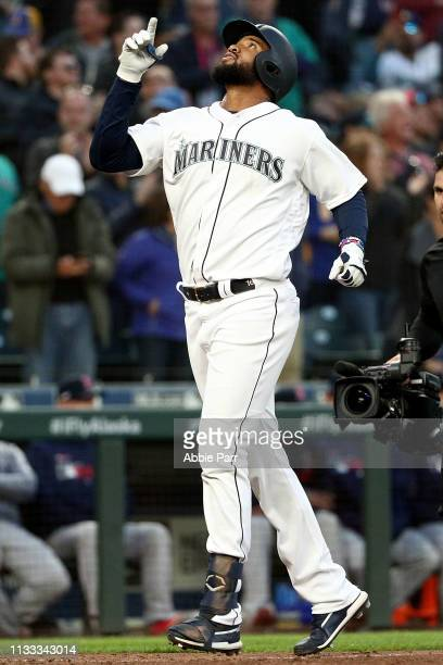 Domingo Santana of the Seattle Mariners celebrates while crossing home after hitting a two run home run against the Boston Red Sox in the seventh...