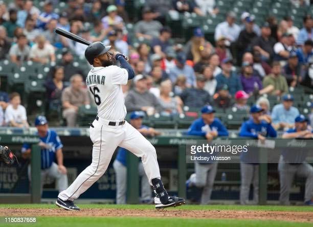 Domingo Santana of the Seattle Mariners follows through on a solo home run in the sixth inning against the Kansas City Royals at TMobile Park on June...