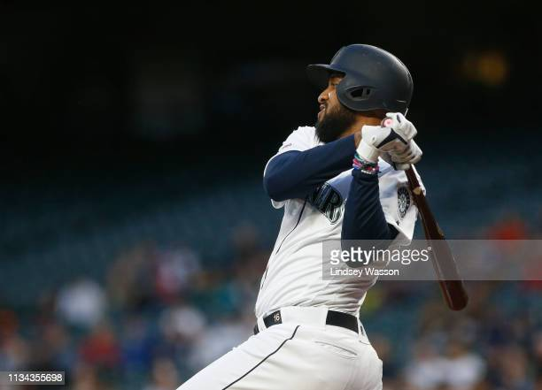 Domingo Santana of the Seattle Mariners follows through on an RBI single against the Los Angeles Angels of Anaheim in the first inning at TMobile...