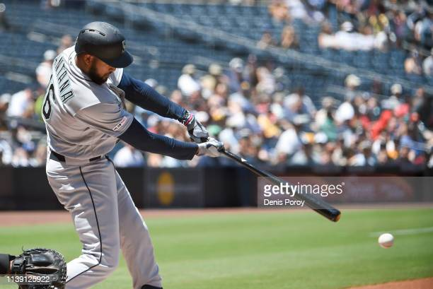 Domingo Santana of the Seattle Mariners hits a single during the first inning of a baseball game against the San Diego Padres at Petco Park April 24...