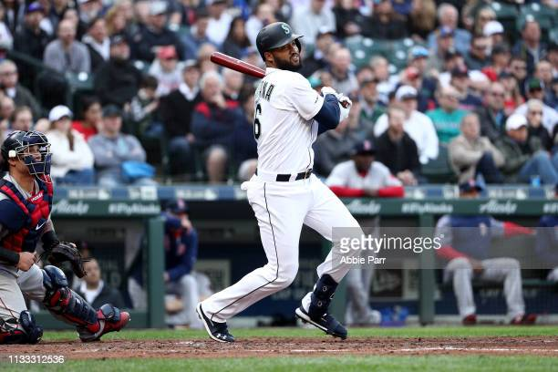 Domingo Santana of the Seattle Mariners hits a two run double against the Boston Red Sox in the second inning during their Opening Day game at...