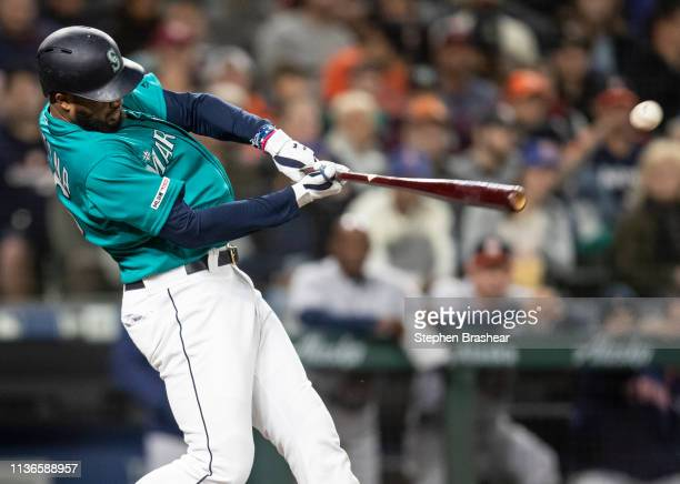 Domingo Santana of the Seattle Mariners hits a tworun single off of starting pitcher Wade Miley of the Houston Astros to score Mitch Haniger of the...