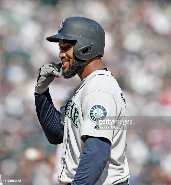 Domingo Santana of the Seattle Mariners motions to a teammate in the dugout after his rbi single in the sixth inning against the Chicago White Sox at...