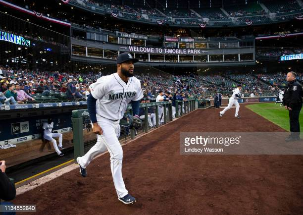 Domingo Santana of the Seattle Mariners runs out onto the the field before the game against the Los Angeles Angels of Anaheim at T-Mobile Park on...