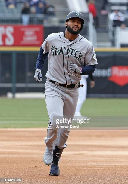 Domingo Santana of the Seattle Mariners runs the bases after hitting a solo home run against the Chicago White Sox in the 1st inning during the...