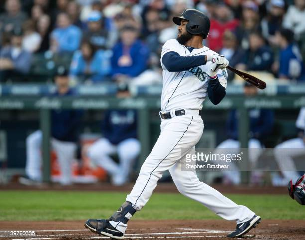 Domingo Santana of the Seattle Mariners takes as swing during an atbat in a game against the Boston Red Sox at TMobile Park on March 30 2019 in...