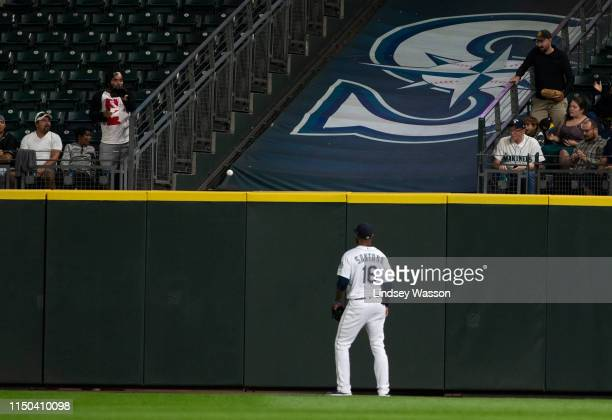 Domingo Santana of the Seattle Mariners watches the home run by Jorge Soler of the Kansas City Royals in the eighth inning at TMobile Park on June 17...