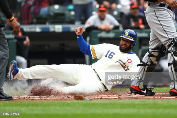 Domingo Santana scores off an RBI double by Daniel Vogelbach of the Seattle Mariners in the first inning during their game at TMobile Park on June 22...