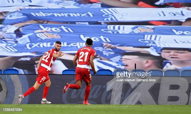 Domingos Duarte of Granada celebrates after he scores their third goal during the Liga match between Real Sociedad and Granada CF at Estadio Anoeta...