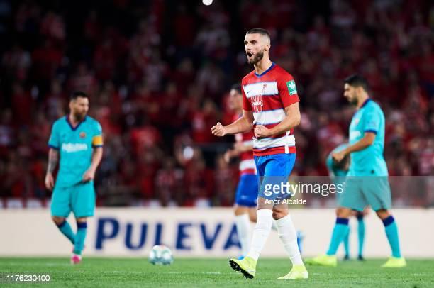 Domingos Duarte of Granada CF celebrates after his teammate Alvaro Vadillo scored during the Liga match between Granada CF and FC Barcelona at...