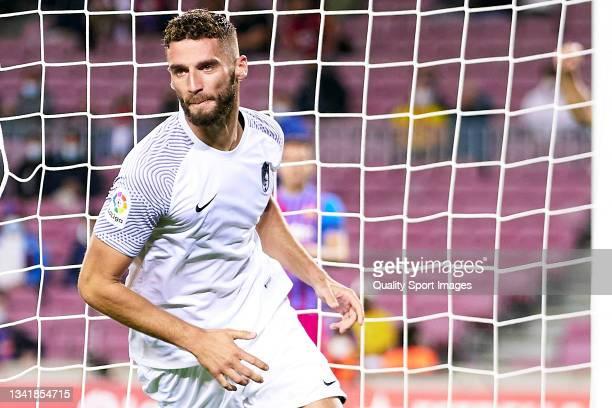 Domingos Duarte of Granada CF celebrates his team's first goal during the La Liga Santander match between FC Barcelona and Granada CF at Camp Nou on...