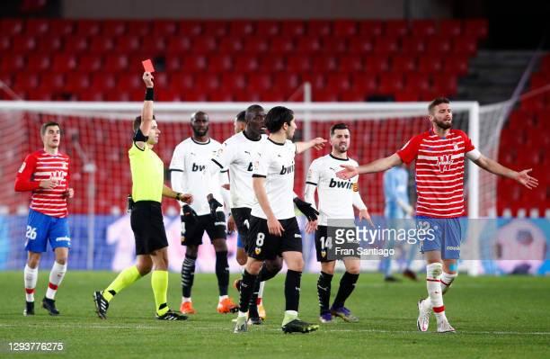 Domingos Duarte of Granada CF is shown a red card by Referee Adrian Cordero Vega during the La Liga Santander match between Granada CF and Valencia...