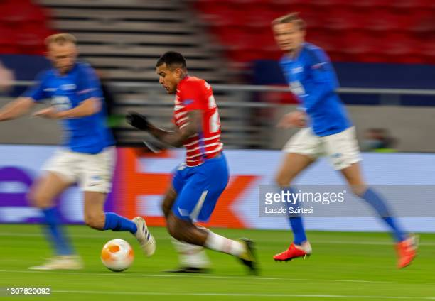 Domingos Duarte of Granada CF runs with the ball during the UEFA Europa League Round of 16 Second Leg match between Molde and Granada at Puskas Arena...