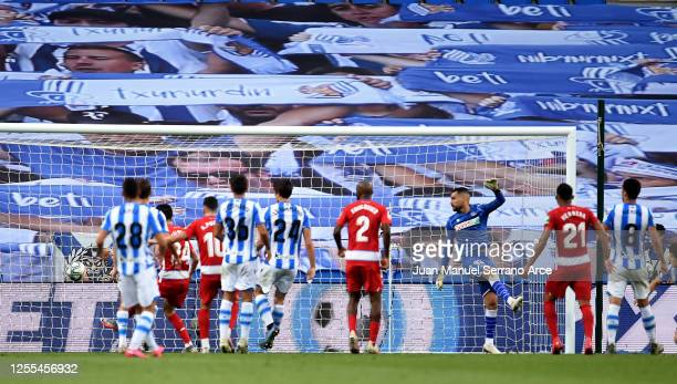 Domingos Duarte of Granada scores their third goal during the Liga match between Real Sociedad and Granada CF at Estadio Anoeta on July 10 2020 in...