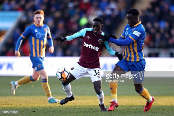 Domingos Quina of West Ham United is challenged by Arthur Gnahoua of Shrewsbury Town during The Emirates FA Cup Third Round match between Shrewsbury...