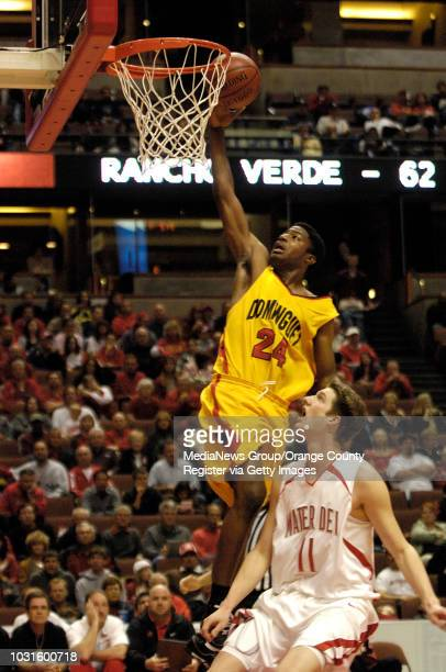 ANAHEIM CA Dominguez' Robert Mandingo goes up for a shot over Mater Dei's Andy Brown during the CIFSS Division I championship game at the Honda...