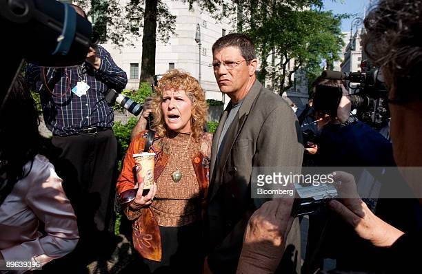 Dominic and Ronnie Sue Ambrosino victims of Bernard Madoff founder of Bernard L Madoff Investment Securities LLC speak to the media outside federal...