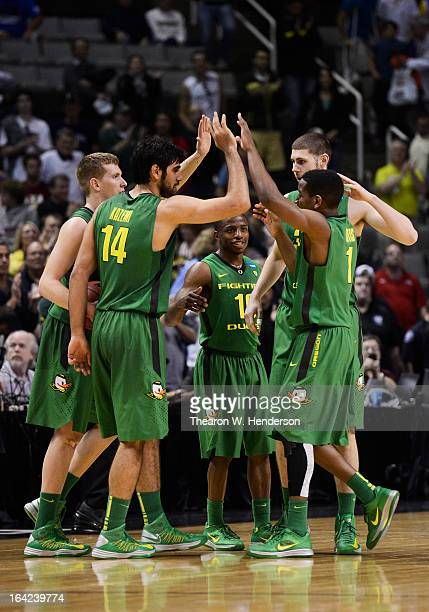 Dominic Artis Ben Carter Arsalan Kazemi Johnathan Loyd and EJ Singler of the Oregon Ducks celebrate their 68 to 55 win over the Oklahoma State...