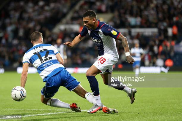 Dominic Ball of Queens Park Rangers and Karlan Grant of West Bromwich Albion during the Sky Bet Championship match between West Bromwich Albion and...