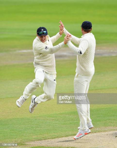 Dominic Bess of England celebrates after running out Roston Chase of West Indies with Stuart Broad of England during Day Five of the Ruth Strauss...
