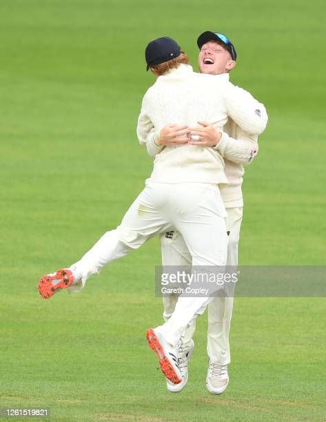 Dominic Bess of England celebrates after running out Roston Chase of West Indies with Ollie Pope of England during Day Five of the Ruth Strauss...