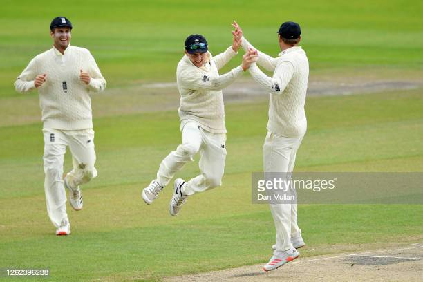 Dominic Bess of England celebrates with Stuart Broad of England after running out Roston Chase of West Indies during Day Five of the Ruth Strauss...
