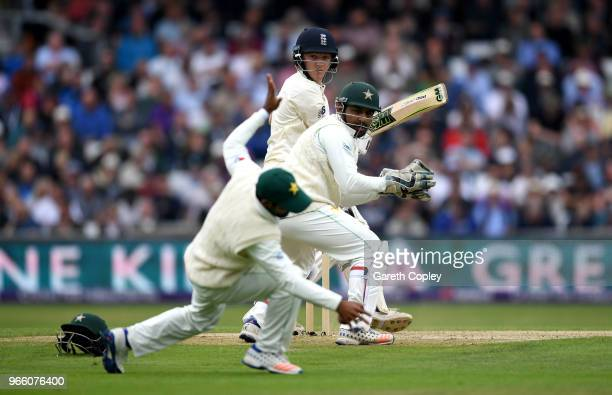 Dominic Bess of England hits past Pakistan wicketkeeper Sarfraz Ahmed and Asad Shafiq during day two of the 2nd NatWest Test match between England...