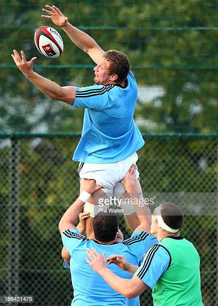 Dominic Bird of the All Blacks takes the ball in the lineout during a New Zealand All Blacks training session at the Kubota Rugby Club on October 31...