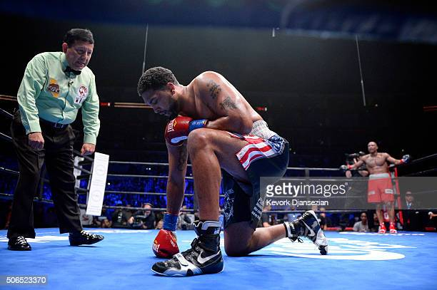 Dominic Breazeale is knocked down by Amir Mansour during the heavyweight bout at Staples Center January 23 2016 in Los Angeles California Breazeale...