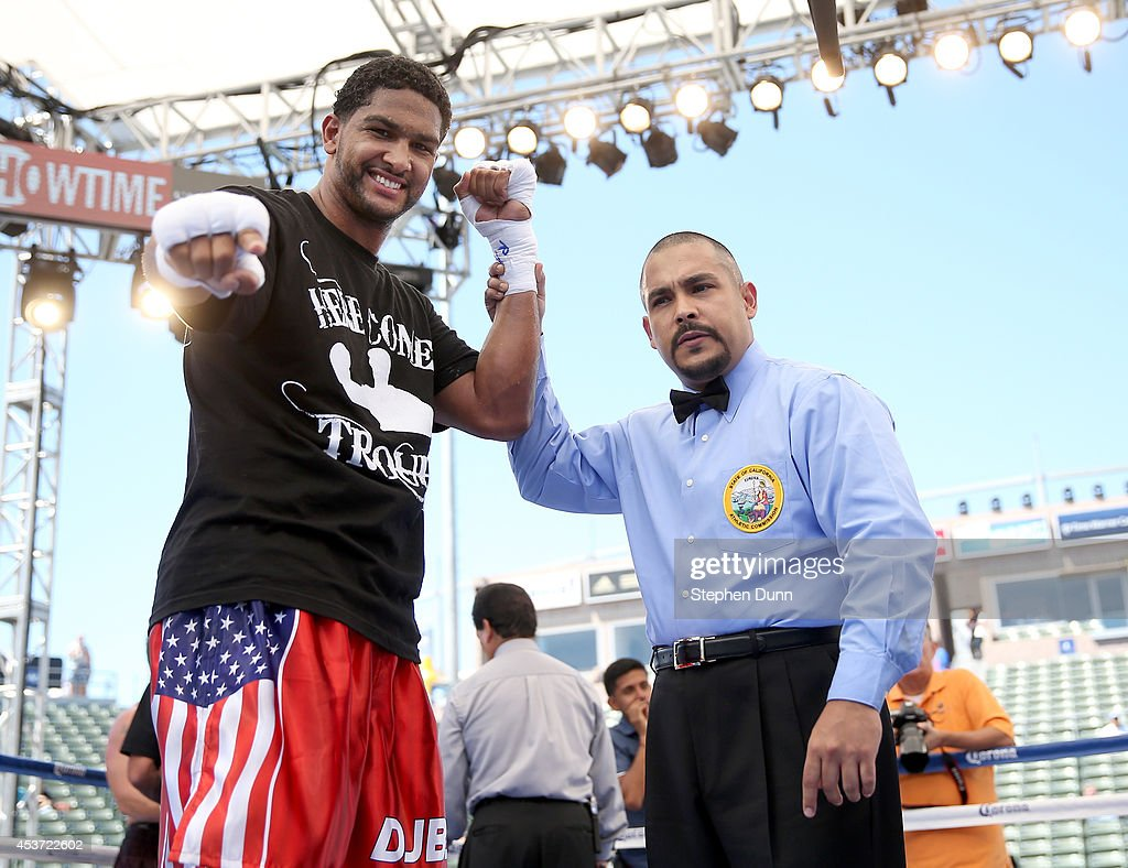 Dominic Breazeale poses with referee Raul Caiz Jr. after defeating Billy Zumbrun in a heavywieght fight at StubHub Center on August 16, 2014 in Los Angeles, California.
