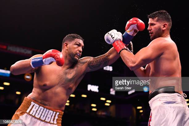 Dominic Breazeale punches Carlos Negron during their Heavyweights bout at Barclays Center on December 22 2018 in the Brooklyn borough of New York City
