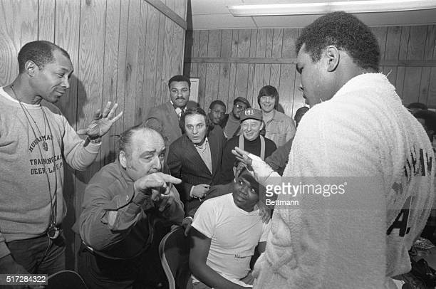 Dominic Bufano gives heavyweight champ Muhammad Ali the evil eye during a news conference at the Coliseum. Bufano claims he can put a hex on anybody...