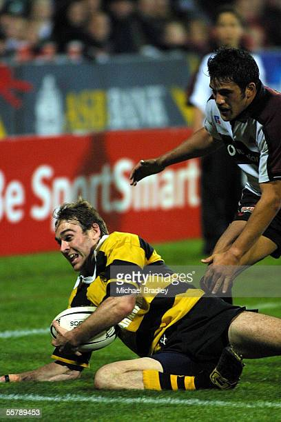 Dominic Byrne of Taranaki has to hurry back to secure the ball close to his line as Willie Walker looms from North Harbour during the rugby NPC game...