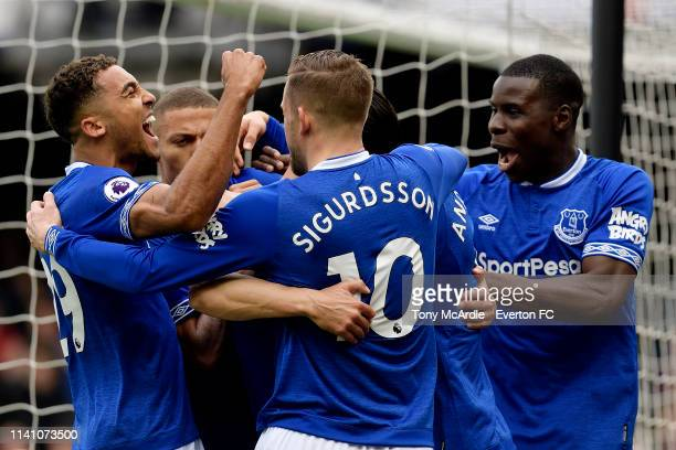 Dominic CalvertLewin and Kurt Zouma celebrate the goal of Phil Jagielka during the Premier League match between Everton and Arsenal at Goodison Park...