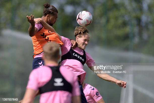 Dominic Calvert-Lewin and Lewis Gibson challenge for the ball during the Everton training session at USM Finch Farm on August 21 2020 in Halewood,...