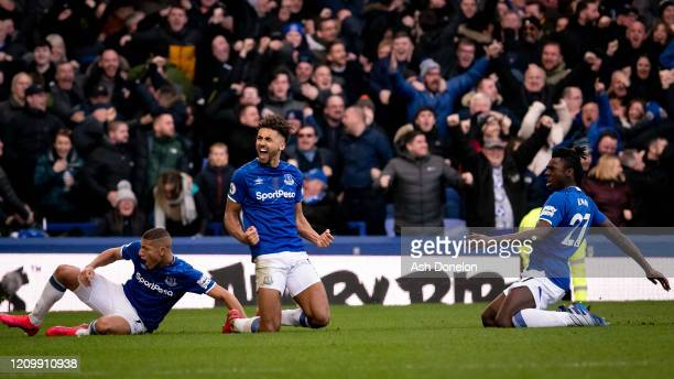Dominic CalvertLewin and Richarlison of Everton celebrate only for the goal to be rule out for offside during the Premier League match between...