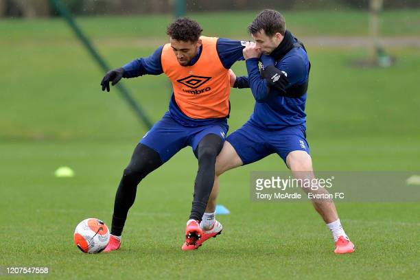 Dominic Calvert-Lewin and Seamus Coleman challenge for the ball during the Everton training session at USM Finch Farm on February 19 2020 in...