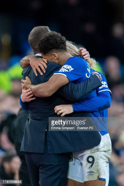 Dominic Calvert-Lewin and Tom Davies of Everton embrace their interim manager Duncan Ferguson after scoring their teams third goal during the Premier...