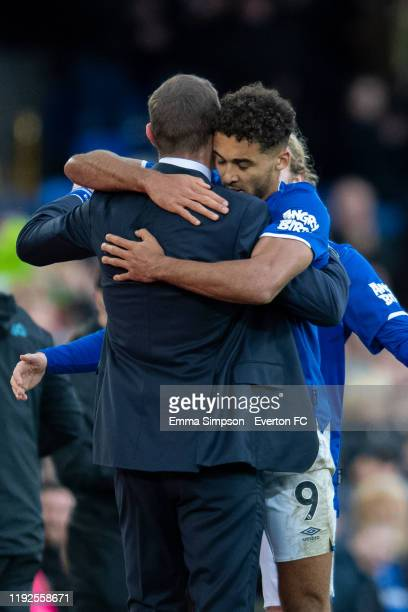 Dominic CalvertLewin and Tom Davies of Everton embrace their interim manager Duncan Ferguson after scoring their teams third goal during the Premier...