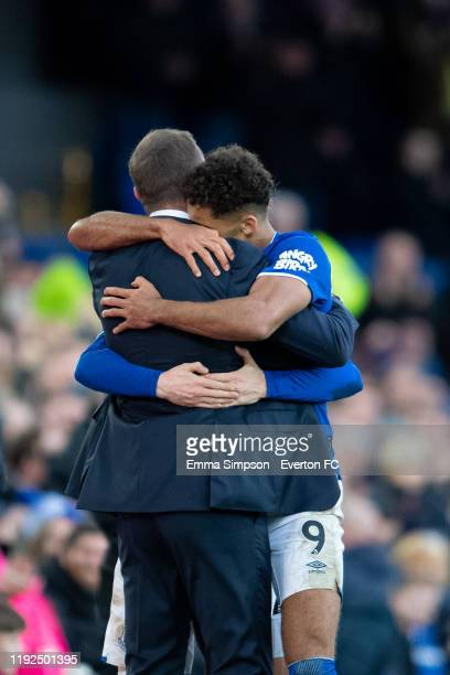 Dominic Calvert-Lewin and Tom Davies of Everton embrace their manager Duncan Ferguson after scoring their teams third goal during the Premier League...