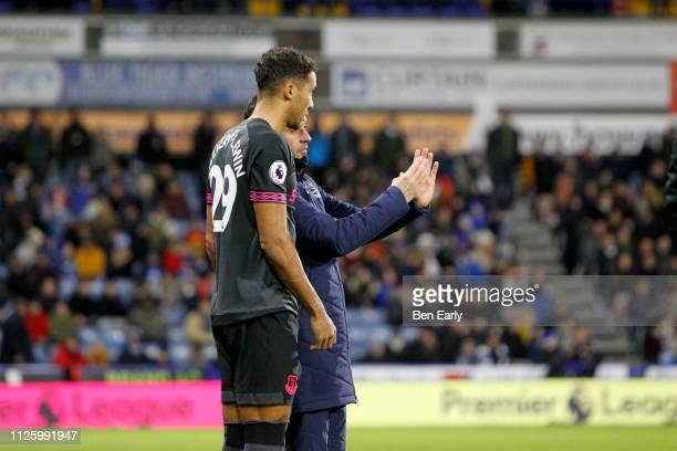 Dominic CalvertLewin gets instructions from Marco Silva before being substituted on during the Premier League match between Huddersfield Town and...