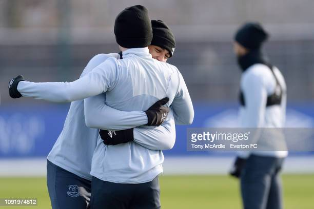 Dominic CalvertLewin hugs Jonjoe Kenny during the Everton training session at USM Finch Farm on January 31 2019 in Halewood England
